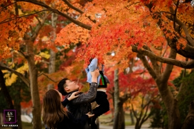 Hangzhou City Zhejiang Fall Leaves Lifestyle Portraits - Photo contains: park, color, trees, orange, mother, father, son, picture