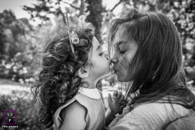 Sao Paulo Brazil Mom with Daughter Lifestyle Portraits | Photo contains:, mother, daughter, outside, black, white, trees, kiss, nose, close-up