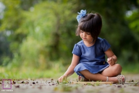 Sao Paulo Young Child Lifestyle Portraits | Photo contains: girl, Brazilian, trees, outdoors, flower, colorful, tips, shot