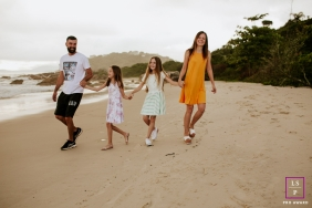 Florianopolis Beach Family Lifestyle Photography Santa Catarina  | Image contains:  mom, dad, girls, beach, sand, water, picture