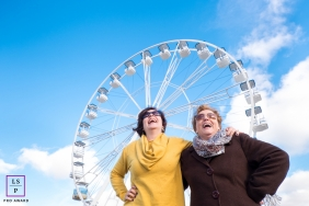 Portugal Family Lifestyle Portrait Session | Photo contains: women, laugh, blue, sky, ferris wheel