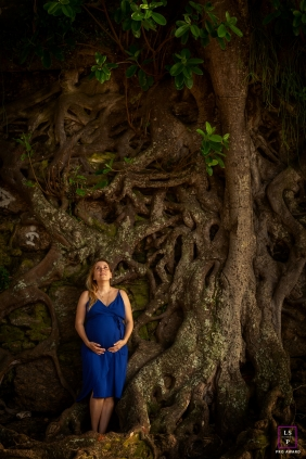 Solo Macae Maternity Lifestyle Portrait Session | Photo contains: Rio de Janeiro, pregnancy, woman, tree roots, plants, vertical, blue, color, creative