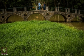Couple Lifestyle Portrait Session in Sao Paulo | Photo contains: bridge, lake, grass, father to be, mother to be, color, trees
