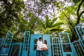 Sao Paulo Maternity Lifestyle Portraits | Photo Session contains: jungle, colorful, green, blue, doors, windows, couple, bump