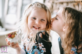 Nashville	Family Lifestyle Portrait Session | Photo contains: Tennessee, close-up, color, little girls, sisters, indoors, teacup, camera