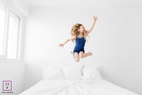 Bouches-du-Rhone Lifestyle Family Portraits in the Kid's Bedroom | Image contains: girl, bed, jump, play, fun