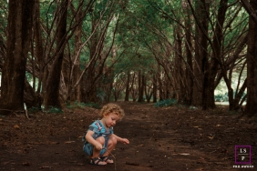 Santa Catarina Lifestyle Children Portraits - Photo contains: child, dirt, trees, stick, color, outdoors
