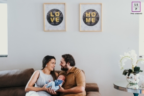 Paranoia Brazil Lifestyle Portraits of Newborn Infant - Photo contains: couple, family, baby, home, sofa, couch