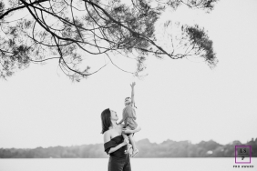 Singapore Asia Lifestyle Family Portrait Session with Mom and Child | Photo contains: black and white, mother, child, tree, water