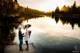Coeur d'Alene	Lifestyle Portrait Photography Idaho | Image contains:  family, baby, lake, trees, dock