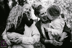 Doubs Lifestyle Family Portraits in Black and White - Photo contains: Bourgogne-Franche-Comte, family, black, white, laughing. outdoors, girls, trees