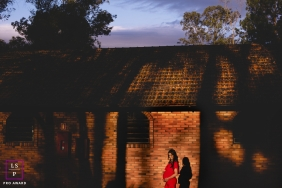 Rio Grande do Sul Lifestyle Maternity Portraits | Photo Session contains: building, outdoors, sunset, shadow, pregnancy, color, trees, mother