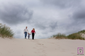 Noord Holland Lifestyle Portraits at the Beach |  Family Photo contains: beach, grass, color, family, sky, sand