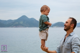 Rio de Janeiro Lifestyle Portraits |  Brazil dad and toddler boy at the beach balancing act