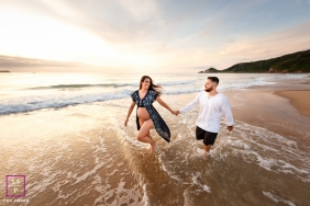 Florianopolis Santa Catarina Lifestyle Maternity Portraits | Photograph contains: beach, waves, color, sunset, pregnant, ocean, couple