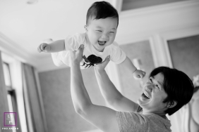 Hangzhou City Lifestyle Family Portrait Session | Zhejiang flying baby in black and white photography