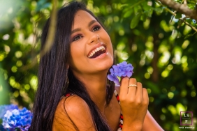 Minas Gerais Lifestyle Teen Photography | Brazil Portrait of young girl holding purple flowers in the trees