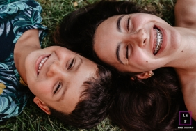 Florianopolis Santa Catarina Family Lifestyle Portrait Photos | Image contains: siblings, smiling, grass, laughing, braces