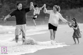 Florianopolis Family Lifestyle Portraits at the beach in Santa Catarina | image contains: Photography of mom, dad, kids, water, waves, beach, sand, fun, children