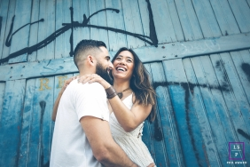 Sao Paulo Brazil Couple Lifestyle Portrait Photography - Image contains: man, woman, engaged, prewedding, session, industrial, graffiti