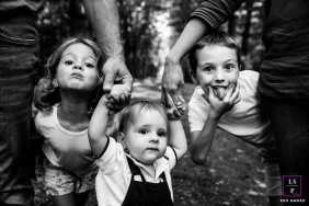 Kid Photographer in Auvergne-Rhone-Alpes | Lifestyle Image: Fun with kids in black and white portrait