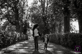 Mother and Son Photographer in Auvergne-Rhone-Alpes | Lifestyle Image contains: portrait, matching, driveway, lane, trees, hedges, black and white