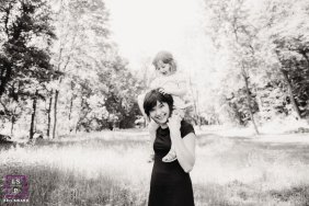 Family Photographer in Alsace Grand Est | Lifestyle Image contains: mother, daughter, field, trees, black and white, grass, nature, portrait