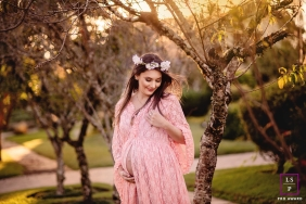 Maternity Photography for Rio Grande do Sul - Lifestyle Portrait contains: flowers, hair, dress, sunlight, afternoon, woman, pregnant