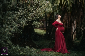 Maternity Portraits in Florianopolis | Lifestyle Photography Session contains: woman, pregnancy, red, dress, trees