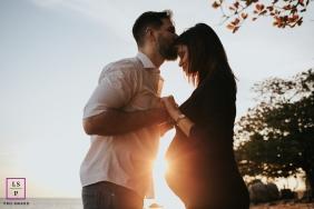 Maternity Photography for Santa Catarina - Florianopolis Lifestyle Portrait contains: couple, sun, trees, kiss