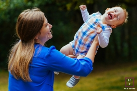 Family Portraits in Seattle | Lifestyle Photography Session contains: Mother swinging her little boy in Washington