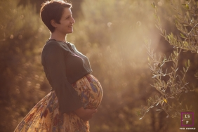 Pistoia maternity photoshoot - Tuscany Sunset portrait with a pregnant woman.