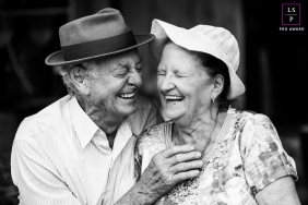Santa Catarina Brazil lifestyle portrait of older couple wearing hats. Laughing with those we love is sublime!