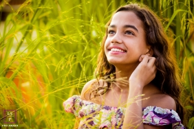 Minas Gerais lifestyle beautiful photograph of this young woman set amongst tall grasses.