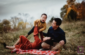 A cool fall evening, laughter of a sweet little one, and the loving embrace of parents. Indiana lifestyle photography session for family portraits.