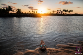 Mato Grosso Brazil pregnancy portraits by the water at sunset with palm trees.