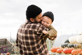 Moselle lifestyle portrait of father and son in beanies by a Grand Est family photographer.