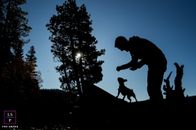 Lake Tahoe lifestyle silhouette portrait of a man and his dog.