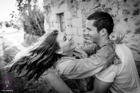 French photographer shot this black and white engagement portrait of a couple holding each other.