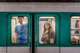 Pays de la Loire Engagement Photography of a couple on a subway train peering out the windows.