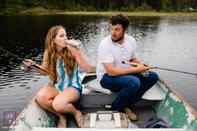 Lifestyle Portrait of a couple fishing and drinking a beer on their small boat in Coeur d'Alene, Idaho