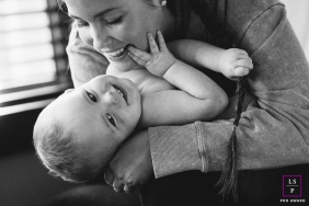 Family lifestyle photo of a Seattle, Washington mom holding baby
