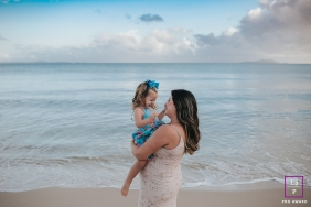 maternity lifestyle session of a pregnant woman with daughter on the beach