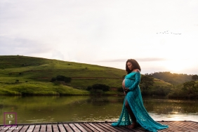 Maternity Portrait of woman on a dock by a lake | Minas Gerais Photographer