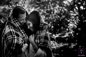 A lovely couple cuddle together under a blanket during this Sao Paulo couple portrait