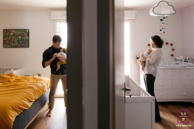 baby twins at home with mum and dad photographed in separate rooms | Herault lifestyle photographer