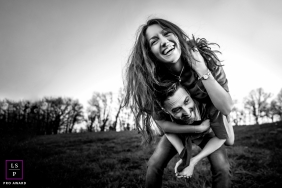 This couple is having fun like children during a photoshoot in Auvergne-Rhone-Alpes