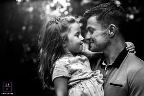 A father and his young daughter look into each other's eyes for this France family portrait