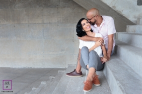 A couple session showing the love between these two people as they sit on concrete steps