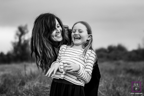 French Lifestyle photo session of girl tickling with mum